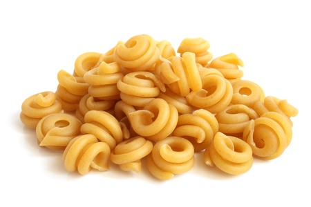 Close-up of italian pasta - spiral shaped, on a white background photo