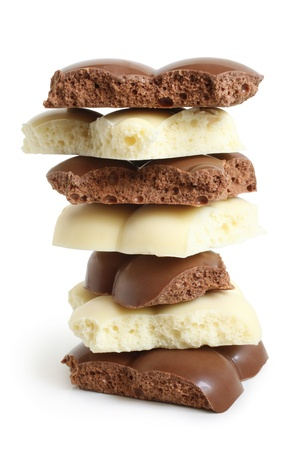 Stack of porous chocolate pieces on a white background photo