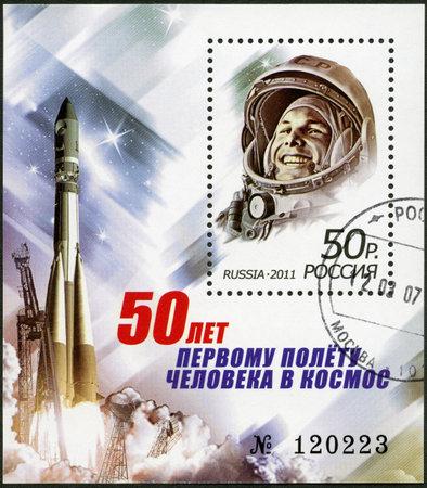 gagarin: RUSSIA - CIRCA 2011: A stamp printed in Russia shows Yuri Gagarin (1934-1968) and spaceship  Editorial