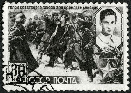 USSR - CIRCA 1942: A stamp printed by USSR shows Nazi Soldiers Leading Zoya Kosmodemjanskaja (1923-1941) to her Death, circa 1942