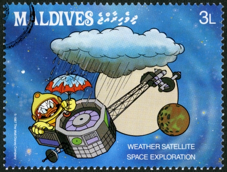 donald: MALDIVE ISLANDS - CIRCA 1987: A stamp printed in Maldive Islands shows Weather satellite, series Disney Characters, Space Exploration, circa 1987
