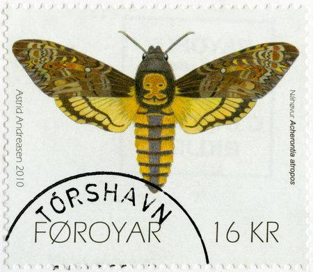 moth: FAROE ISLANDS - CIRCA 2010: A stamp printed in Faroe Islands shows Deaths-head Hawk moth (Acherontia atropos), series Butterflies and Moths, circa 2010 Editorial