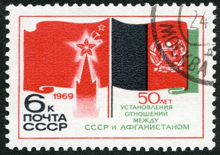 diplomatic: USSR - CIRCA 1969: A stamp printed in USSR shows flags of USSR and Afghanistan, 50th anniversary of diplomatic relations between Russia and Afghanistan, circa 1969