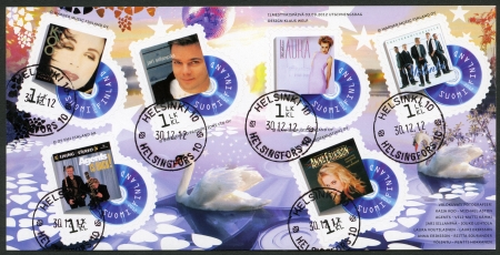 reached: FINLAND - CIRCA 2012: A stamp printed in Finland shows series on Finnish music has reached the 1990s, circa 2012