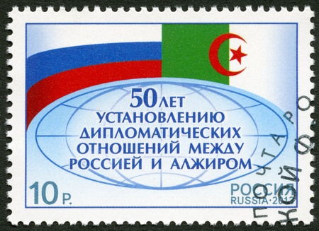 diplomatic: RUSSIA - CIRCA 2013: A stamp printed in Russia dedicated the 50th anniversary of establishment of diplomatic relations between Russia and Algeria,circa 2013 Editorial