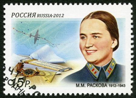 RUSSIA - CIRCA 2012: A stamp printed in Russia dedicated the 100th birth anniversary Marina Mikhailovna Raskova (1912-1943), aviatress, circa 2012