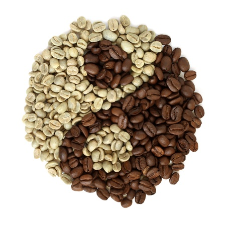 Coffee grains beans forming a yin yang symbol on a white background