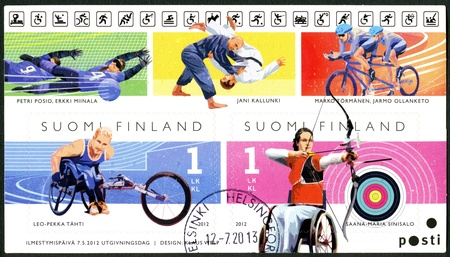 disabled sports: FINLAND - CIRCA 2012: A stamp printed in Finland shows Finnish Champions in disabled sports, wheelchair racer Leo-Pekka Tähti and para-archer Sanna-Maria Sinisalo, series Summer Paralympic Games, circa 2012