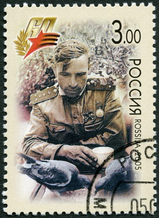 vehement: RUSSIA - CIRCA 2005: A stamp printed in Russia shows at intervals between the battles, the Kalininsky Front, 1943 (a sitting soldier), 60th anniversary of Victory in the Great Patriotic War of 1941-1945, circa 2005