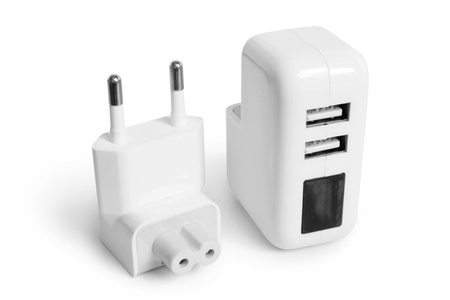 over voltage: Electrical adapter to USB ports on a white background
