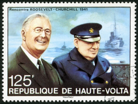 united states postal service: REPUBLIC OF UPPER VOLTA, BURKINA FASO - CIRCA 1975: A stamp printed in Republic of Upper Volta shows portrait of Churchill meeting with Roosevelt, 1941, circa 1975