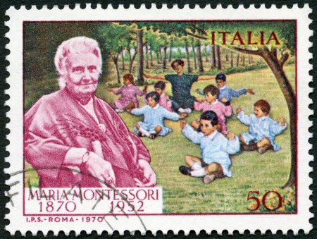 maria: ITALY - CIRCA 1970: A stamp printed in Italy shows Dr. Maria Montessori (1870-1952) and Children, circa 1970
