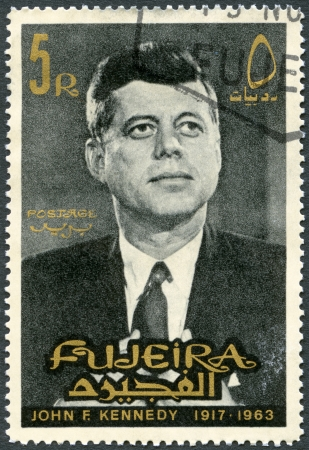 assassinated: FUJEIRA - CIRCA 1965: A stamp printed in Fujeira shows Portrait of John F. Kennedy (1917-1963), circa 1965 Editorial