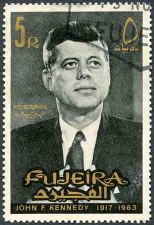 fujeira: FUJEIRA - CIRCA 1965: A stamp printed in Fujeira shows Portrait of John F. Kennedy (1917-1963), circa 1965 Editorial