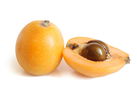 Loquat medlar on a white