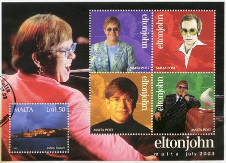 john: MALTA - CIRCA 2003: A stamp printed in Malta shows Elton John Hercules (Reginald Kenneth Dwight) a singer, circa 2003 Editorial