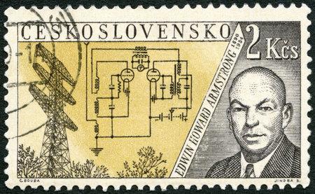 telegraphy: Cecoslovacchia - CIRCA 1959: Un timbro stampato in Cecoslovacchia mostra Edwin Howard Armstrong (1890-1954) e la Torre della Ricerca, Alpine, New Jersey, emesso per onorare inventori nel campo della telegrafia e radio, intorno al 1959