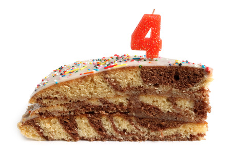 Slice of birthday cake with number four candle on a white background Stock Photo - 23032631