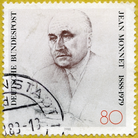 political economist: GERMANY - CIRCA 1988: A stamp printed in Germany shows Jean Monnet (1888-1979), French Statesman, circa 1988 Editorial