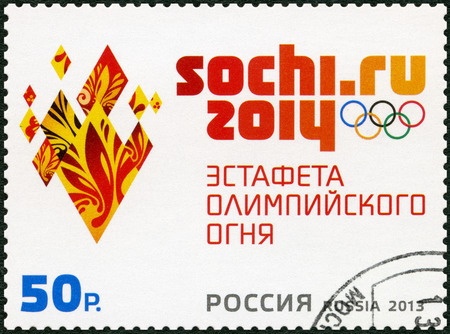 RUSSIA - CIRCA 2013: A stamp printed in Russia shows the emblem of the Olympic Torch Relay of the XXII Olympic Winter Games 2014 in Sochi, circa 2013