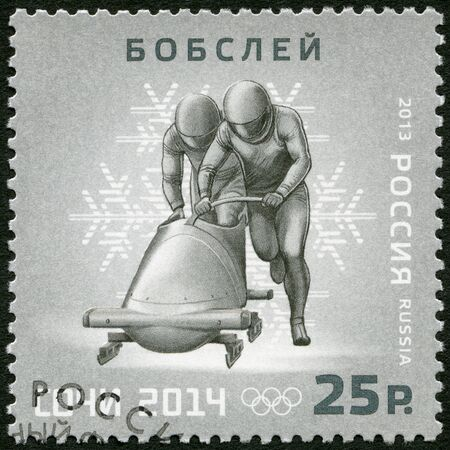 RUSSIA - CIRCA 2013: A stamp printed in Russia shows XXII Olympic Winter Games in Sochi 2014, Olympic winter Sports, bobsleigh, circa 2013