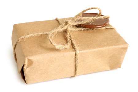 shipment parcel: Parcel with sealing wax on white background