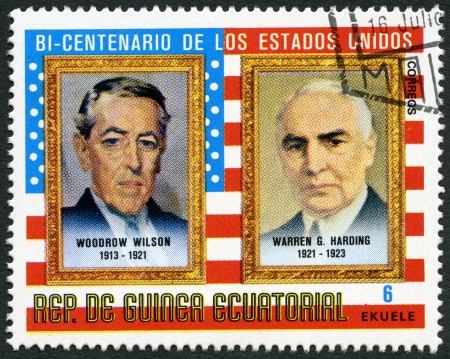 commemorating: EQUATORIAL GUINEA - CIRCA 1975: A stamp printed in Equatorial Guinea shows Presidents Woodrow Wilson (1913-1921) and Warren G. Harding (1921-1923), commemorating the bicentennial of the USA, circa 1975