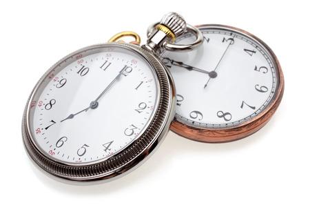 reloj antiguo: Relojes de bolsillo sobre un fondo blanco Foto de archivo