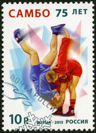 sambo: RUSSIA - CIRCA 2013: A stamp printed in Russia dedicated the 75 Years of Sambo, circa 2013