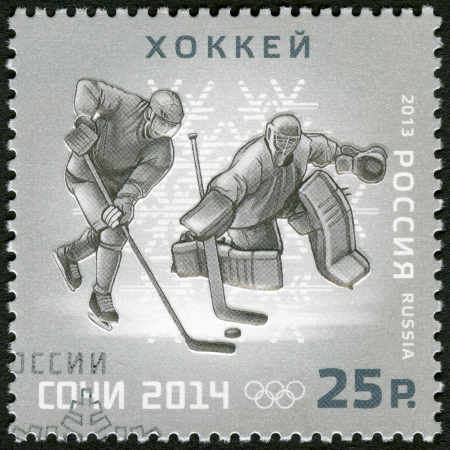 paralympic: RUSSIA - CIRCA 2013: A stamp printed in Russia shows XXII Olympic Winter Games in Sochi 2014, Olympic winter Sports, ice hockey, circa 2013