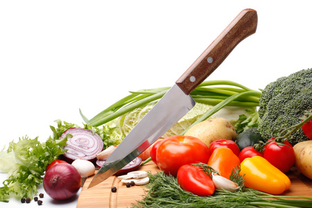 Fresh vegetables with knife on white background Stock Photo - 24493259