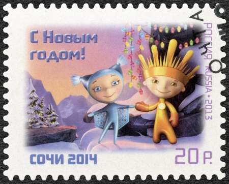 olympic symbol: RUSSIA - CIRCA 2013: A stamp printed in Russia shows Mascots of XI Paralympic Games in Sochi 2014 - Snowflake and Ray, circa 2013  Editorial