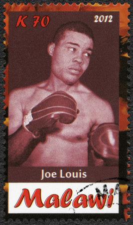 joe louis: Malawi - CIRCA 2012  A stamp printed in Malawi shows Joe Louis, circa 2012