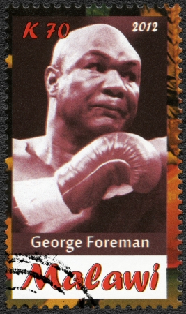 Malawi - CIRCA 2012: A stamp printed in Malawi shows George Foreman, circa 2012