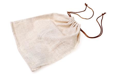 tela algodon: Bolsa de arpillera vac�o en el fondo blanco Foto de archivo