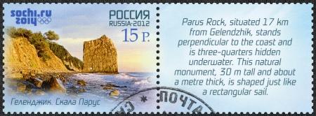 olympic symbol: RUSSIA - CIRCA 2012: A stamp printed in Russia shows Parus Rock near Gelendzhik, Russian Black Sea coast tourism, XXII Olympic Winter Games 2014 in Sochi, circa 2012