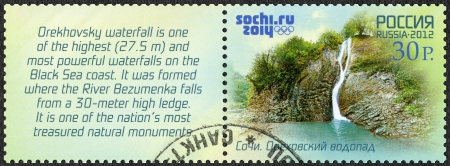 olympiad: RUSSIA - CIRCA 2012: A stamp printed in Russia shows Orekhovsky Waterfall, Russian Black Sea coast tourism, XXII Olympic Winter Games 2014 in Sochi, circa 2012  Editorial