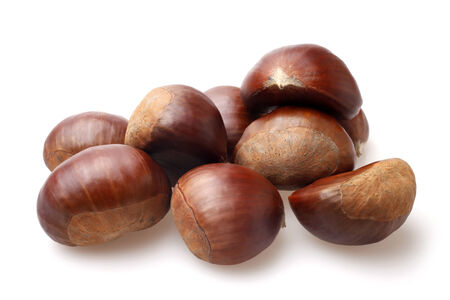 Delicious chestnuts on white  photo