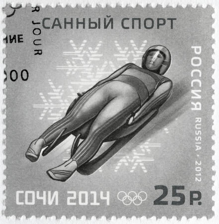 paralympic: RUSSIA - CIRCA 2012  A stamp printed in Russia shows XXII Olympic Winter Games in Sochi 2014, Olympic winter Sports, luge, circa 2012 Editorial