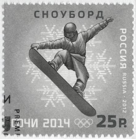 olympic symbol: RUSSIA - CIRCA 2012: A stamp printed in Russia shows XXII Olympic Winter Games in Sochi 2014, Olympic winter Sports, snowboarding, circa 2012
