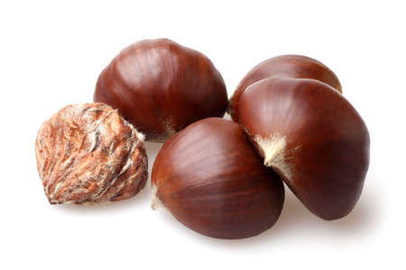 Delicious chestnuts on white background photo