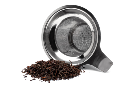 tea strainer: Tea strainer with a handful of tea on white background