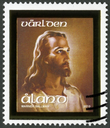 jesus face: ALAND - CIRCA 2010: A stamp printed in Aland shows Head of Christ, circa 2010