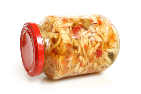 pickled: Preserved cabbage and red paprika salad in glass jar on a white  Stock Photo
