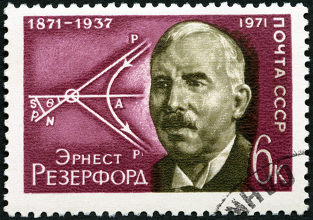 USSR - CIRCA 1971: A stamp printed in USSR shows Ernest Rutherford (1871-1937) and Diagram of Movement of Atomic Particles, circa 1971
