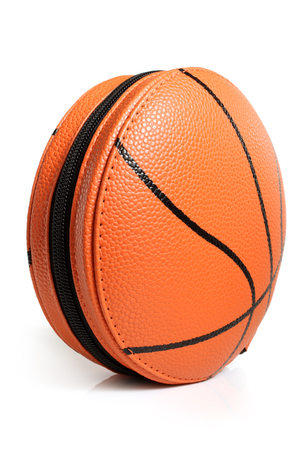 CD case in shape of basket ball on white background photo