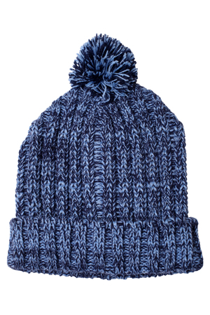 frost bound: Warm woolen knitted hat with pompon isolated on white background