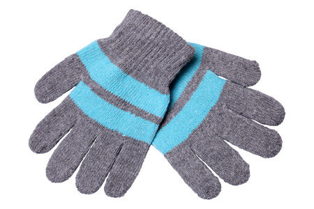 Warm woolen knitted gloves isolated on a white background photo