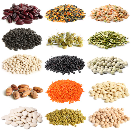 Selection of various legumes on white background photo