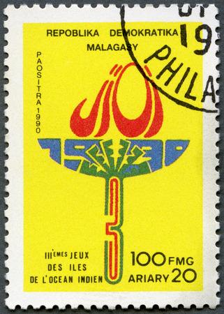 deportes olimpicos: República de Madagascar - alrededor de 1990: Un sello impreso en República de Madagascar (Madagascar) dedicada tercera Océano Índico Juegos, alrededor de 1990